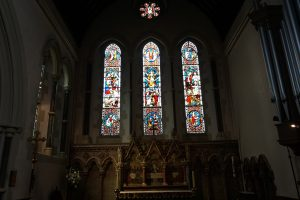 Christ Church Southgate - The altar, reredos, and clerestory in the chancel.